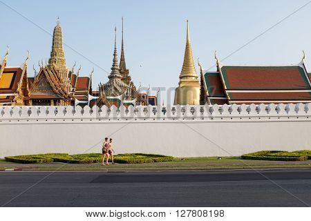 BANGKOKTHAILAND-APRIL 24 : Tourist was walking outside the wall of Wat Phra Kaew, April 23,2016 in Bangkok,Thailand.