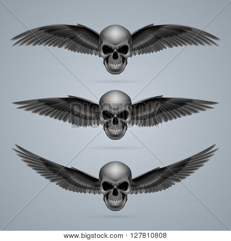 Three evil looking skulls with two wings each.