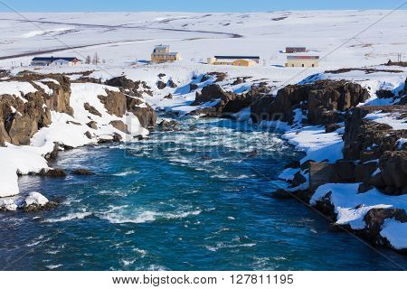 Frozen waterfall with clea blue water at late winter, Gullfoss, Iceland