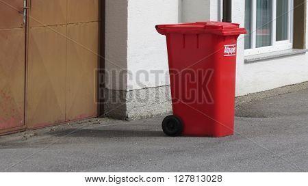 WIEN AUSTRIA - CIRCA APRIL 2016: Altpapier (meaning Old paper or waste paper) red waste containers aka Litter bin garbage bin trash bin or waste bin