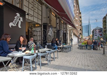 MILAN ITALY - APRIL 29 2016: Daily life of Milan in the street to the new district of Porta Nuova
