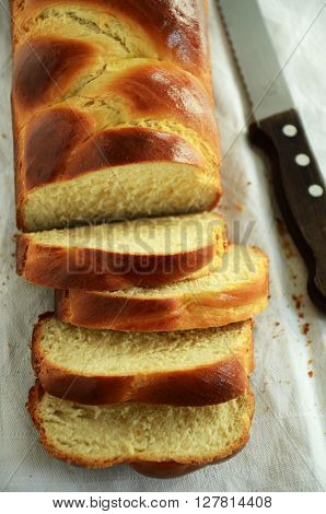 Braided challah bread shaped rectangular and cut in pieces