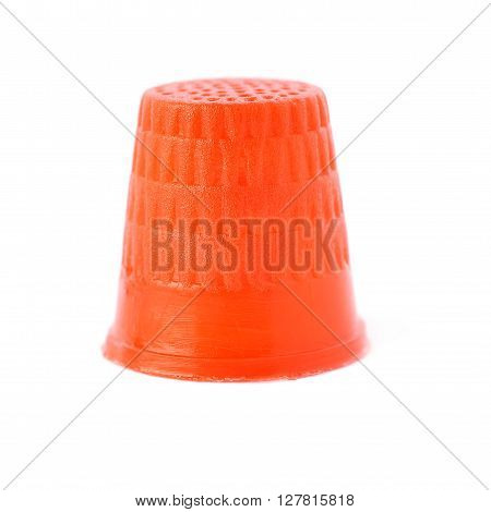 Plastic red thimble isolated over the white background