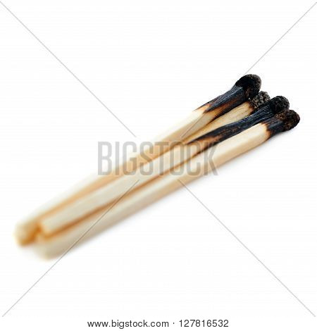 Pile of Wooden used burnt matches isolated over the white background
