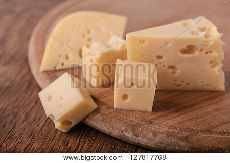 fresh piece of cheese on a wooden background