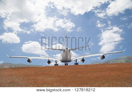 Passenger airplane landing blue sky and cloud  background