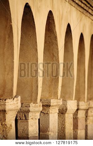Colonnade in Saint Francis Square of Assisi, Italy