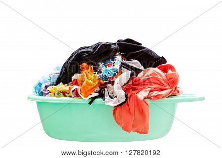 Pile of dirty laundry in a washing basket on white background