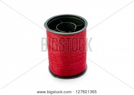Spool of red thread isolated over the white background