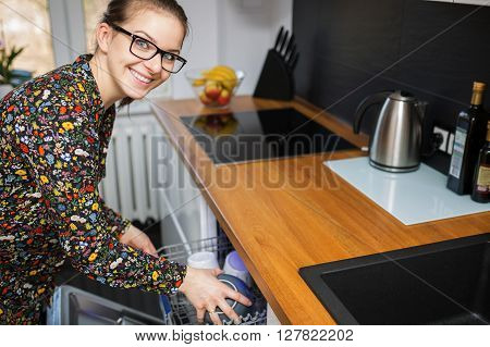 Young Girl Cleaning Up The Kitchen