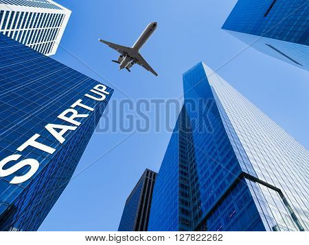 airplane over a business building with the word start up