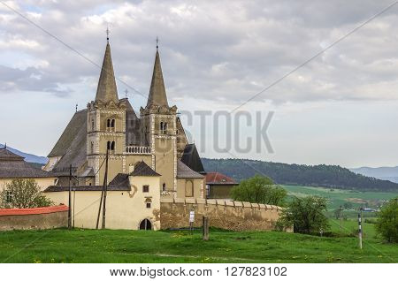 Saint Martins gothic cathedral and wall of fortness from west. Unesco monument. Spisska Kapitula, Slovakia