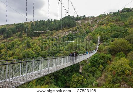 Khndzoresk, Armenia - September 10, 2014:  Khndzoresk Swinging Bridge. Suspension bridge over the gorge near Goris village.
