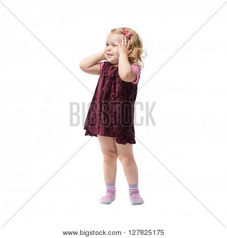 Young indignant little girl with curly hair in purple dress standing over isolated white background