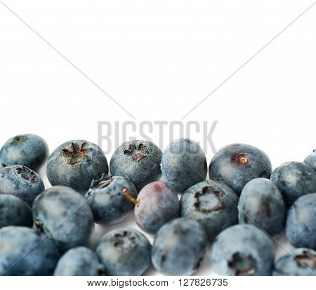Pile of Ripe bilberry or blueberry over isolated white background ** Note: Shallow depth of field
