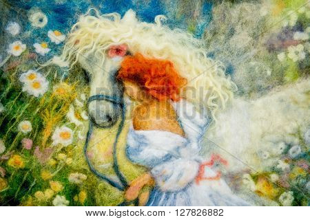 felting wool - contemporary art - handmade. Picture. Girl painting on a white horse on a flower meadow