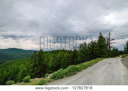 gravel road in a mountain valley at the top of the Altai Mountains
