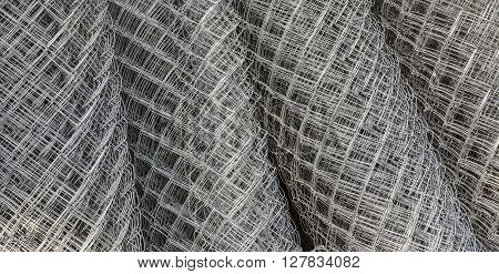 Four bunt metal galvanized wire fence in stock.