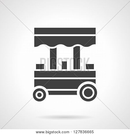 Street trade trolley. Fast food, ice cream, coffee shops on wheels. Mobile trading kiosk. Symbolic black glyph style vector icon. Element for web design and mobile.