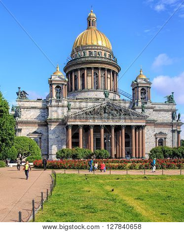 Saint Petersburg, Russia - 9 July, 2015: garden and people in front of the St. Isaac's Cathedral. Saint Isaac's Cathedral in St. Petersburg, Russia, is the largest orthodox basilica in the world.