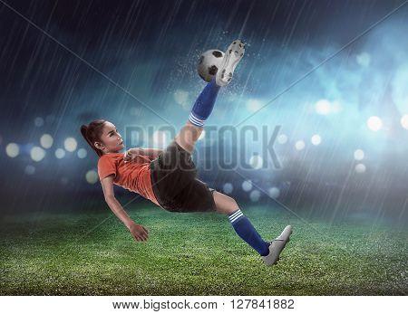 Asian Woman Football Player Kick Ball
