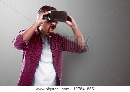 Asian Man Watching Something On Virtual Reality Headset