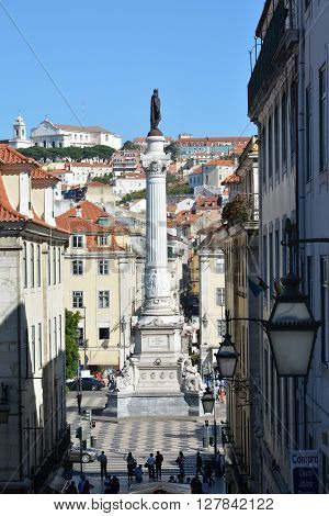 LISBON, PORTUGAL - OCTOBER 21: Rossio Square Column of Pedro IV seen from a narrow street in Barrio Alto district in Lisbon OCTOBER 21, 2015 in Lisbon, Portugal