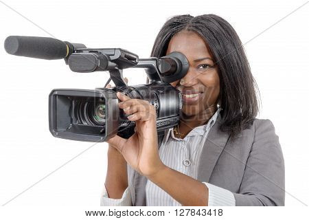 a young African American women with professional video camera