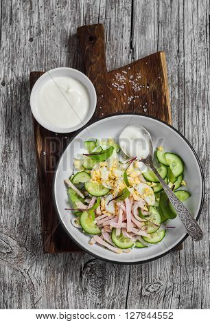 Easy and fast salad with smoked turkey cucumber and boiled egg. Healthy food