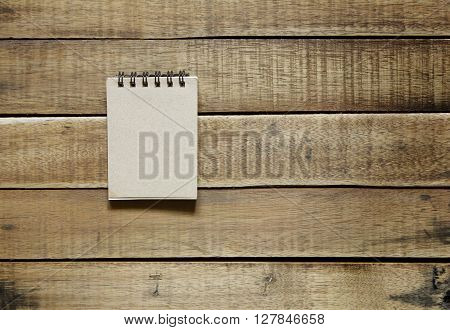 notepaper on wood stationery office equipment on wooden background.