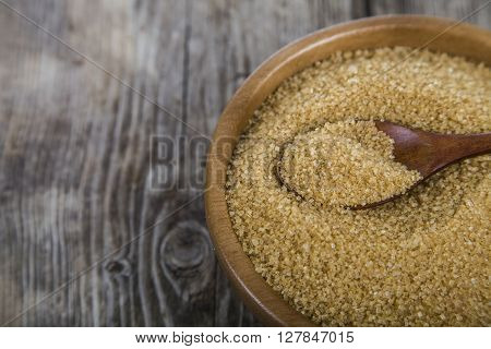 Cane Sugar And Spoon In A Wooden Bowl