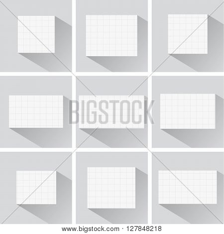 Pieces of cut white squared notebook paper with long shadow are stuck on blue background.