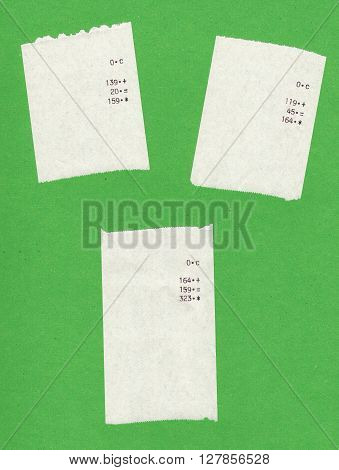 Three bills or receipts isolated over green background