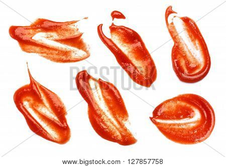Collection of ketchup stains on white background.