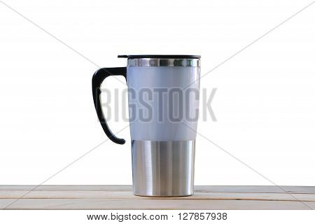 Water glass of aluminum on wooden floor (Aluminum mug) isolated on white background and have clipping paths.