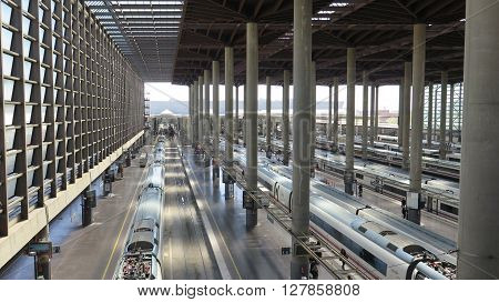 Madrid Spain April 7 2016: Top view of Madrid Atocha Railway station with train and platform. Madrid Spain April 7 2016
