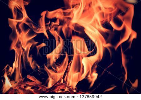 flames in orange color on black background