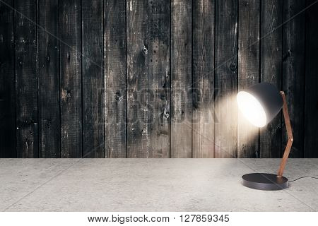 Concrete surface and aged wooden wall with small turned on table lamp. Mock up 3D Renderin