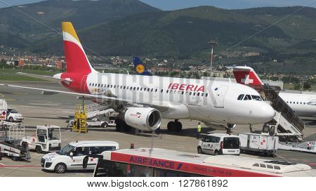 FLORENCE ITALY - CIRCA APRIL 2016: Airbus A 319 aircraft of the Iberia airlines parked at the airport of Florence