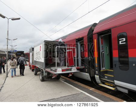 VIENNA AUSTRIA - CIRCA MAY 2014: A train on railroad railway for mass transit public transport calling at a station