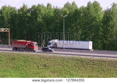 PERM RUSSIA - MAY 30 2015: Trucks move on road. In 2015 in Perm in repair of roads 2.6 billion dollars spent