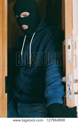 Thief entering the private property. Robbery concept