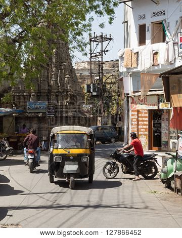 UDAIPUR INDIA - 20TH MARCH 2016: A view of streets and traffic in Udaipur during the day. Traffic and people can be seen.