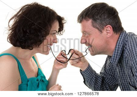 Man And Woman Eating Licorice Forming A Heart With It