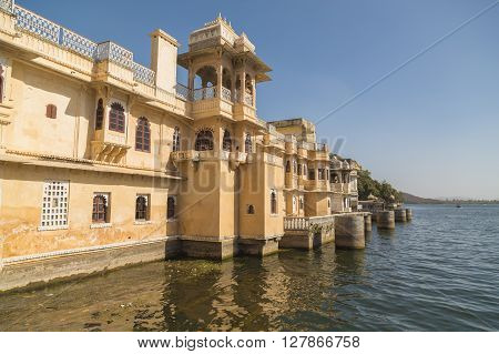 UDAIPUR, INDIA - 20TH MARCH 2016: The outside of architecture by the waterfront in Udaipur
