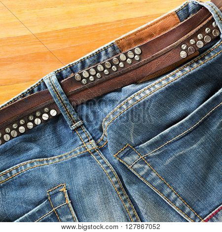 blue jeans with brown leather belt, clothing design