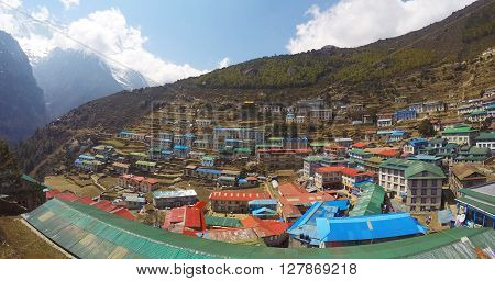 Mountain town landscape, roofs and houses of village Namche Bazaar, climbers base camp, severe nature and nepalese people, living in Himalayan mountains, sunny day cold summer, trek to Everest, Nepal