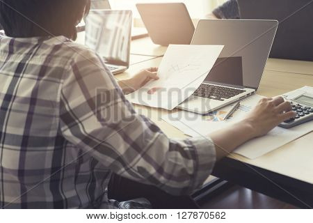 Woman Working With Calculator, Business Document And Computer Notebook, Vintage Tone