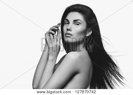 Beautiful fashion young woman with white eyeliner on eyes. Isolated over white background. Copy space.