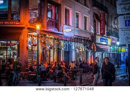 Brussels, Belgium, June 15, 2015 Restaurants, bars and coffee shops at evening in historic part of the city are popular with locals and tourists visiting in Brussels, Belgium